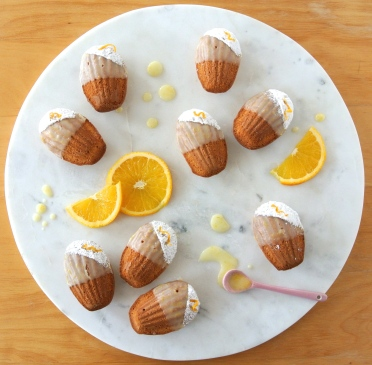 Brown butter and honey madeleines with orange dip