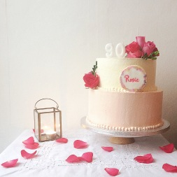 Floral birthday cake with handprinted biscuit plaque
