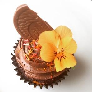 Chocolate orange cupcake with edible flower